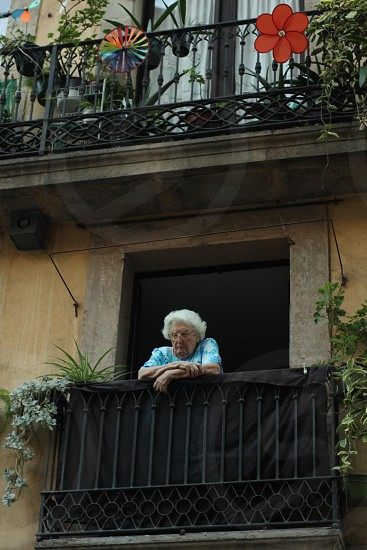 Old lady in the balcony photo