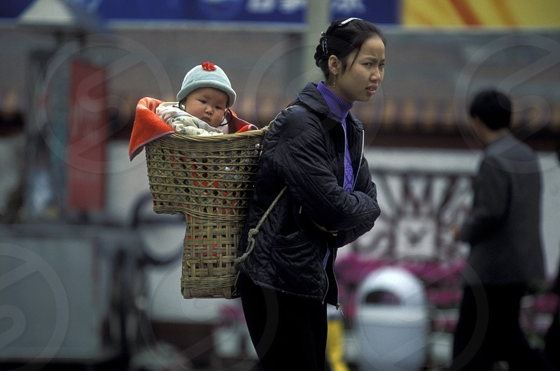 a mother with her baby in the city of Chongqing in the province of Sichuan in china in east asia.  photo