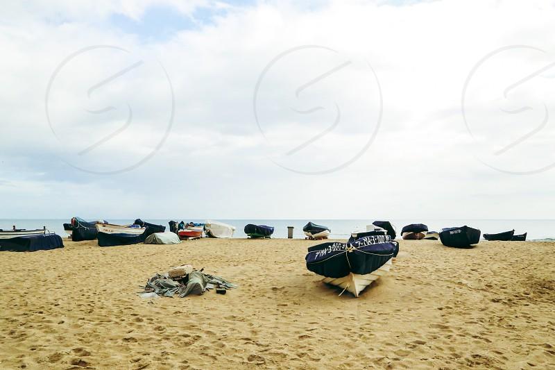 Boating lifestyle  sandy beach beach boats horizon  sea shore photo