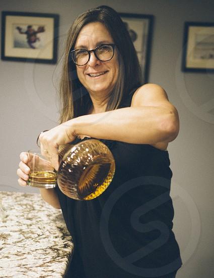 Pouring scotch strong portrait woman photo