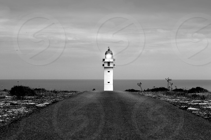 Barbaria lighthouse Formentera from road perspective Balearic Islands photo
