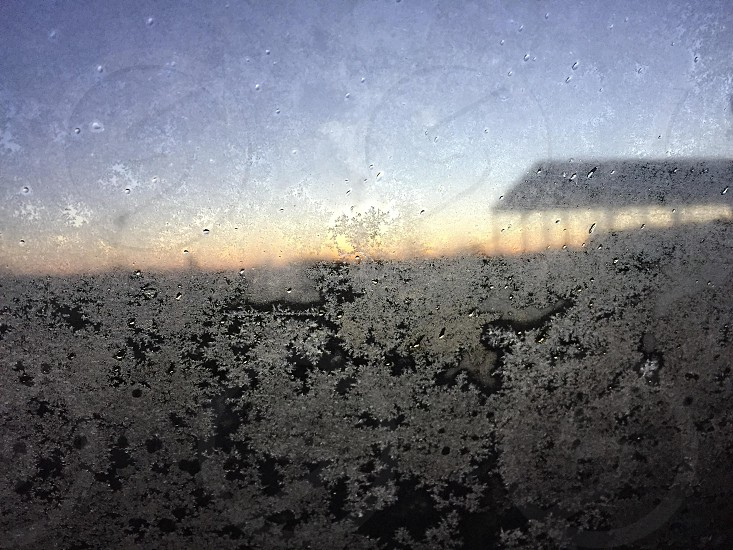 Frosty window in the morning photo
