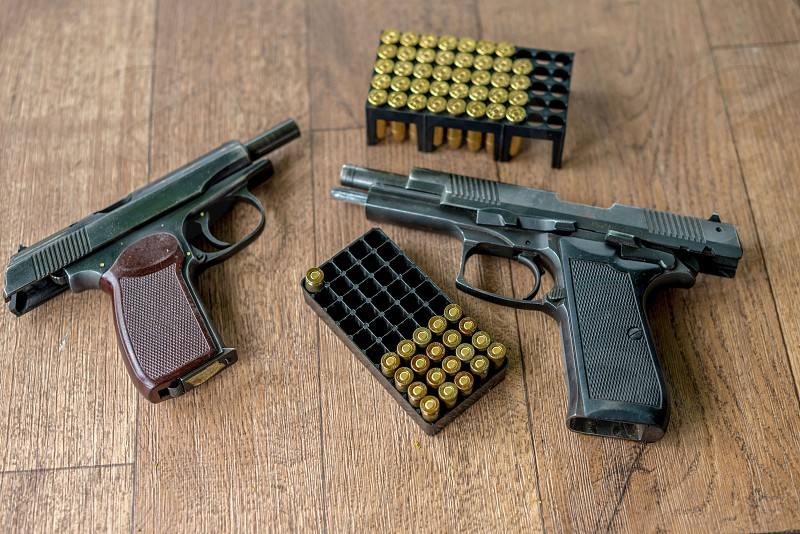 Two pistols and ammunition packs.  photo
