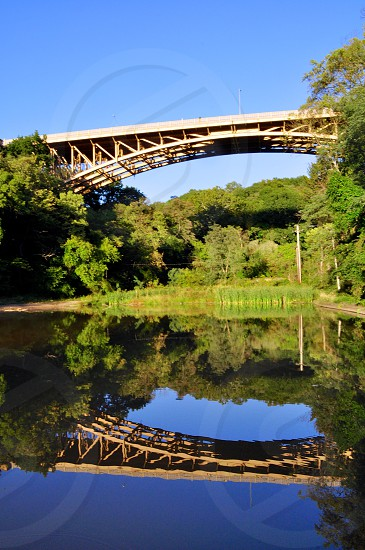 Panther Hollow Bridge reflected in the lake Oakland Pittsburgh.  photo