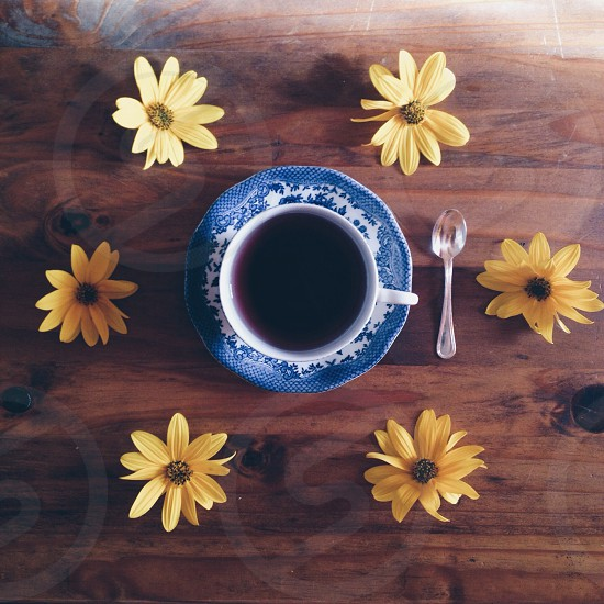 """Tea time"" - Tea mug wooden table flowers photo"