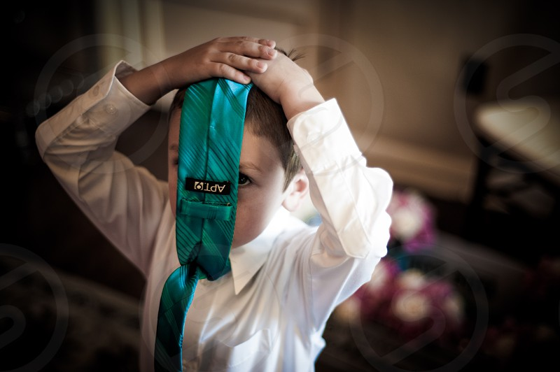 Kid playing with his tie photo