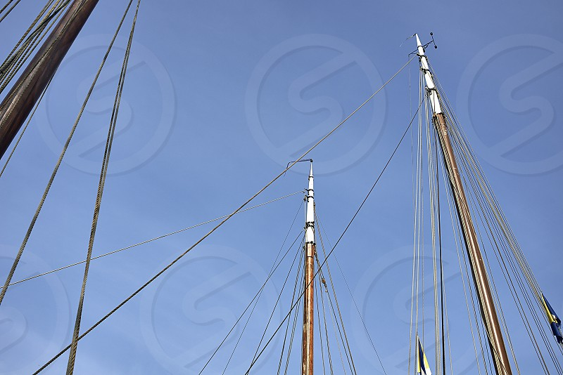 Sailing boats docked in the harbor of a recreational port in a typical Dutch setting in summer sunshine photo