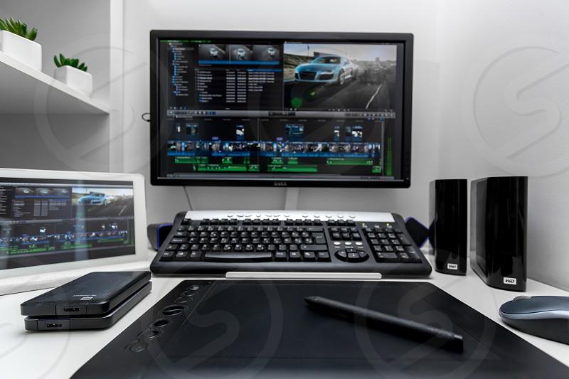 Hard drives on video editors desk photo