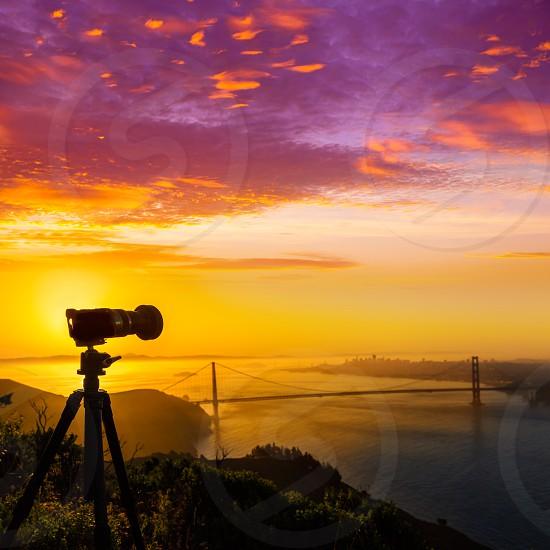 Golden Gate Bridge San Francisco sunrise California USA with photo camera silhouette photo