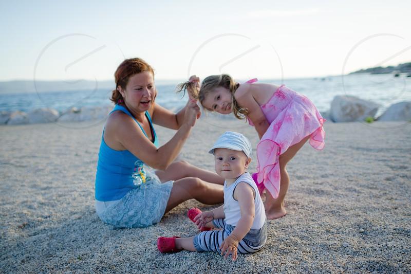 sea beach kids mom sand photo