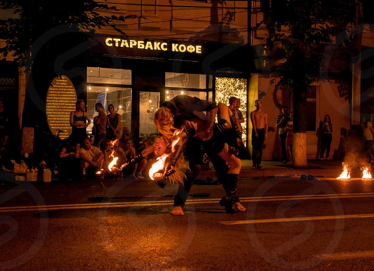 fire dancing on street during nighttime photo