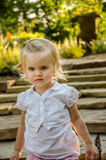 Little Baby Girl Halo Angel Backlit Sunlight Stone Steps Blond Pink Yellow photo