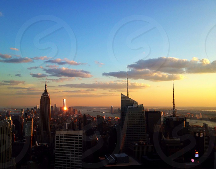 city building over sunset view photo