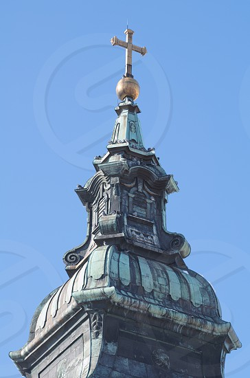 Baroque Church Tower with Clear Blue Sky Vertical photo