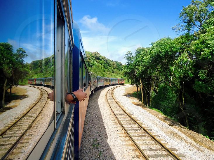 Train vacation travel sky blue vegetation hand reflection photo