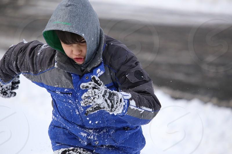 Boy Snow Running Storm Action photo