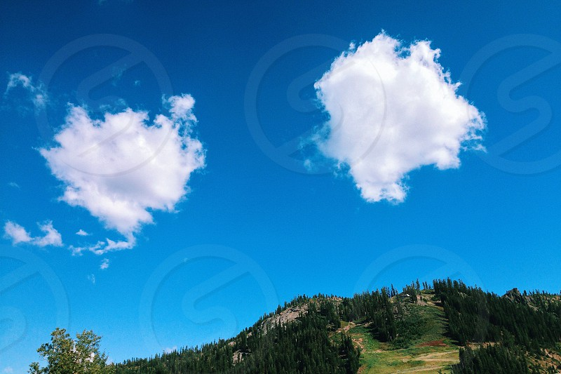 Summer mountains clouds blue sky photo