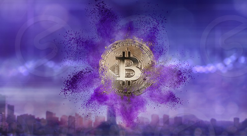 Gold coin bitcoin and explosion of colored powder of ultraviolet on a blurry background of a modern city. Color of the Year 2018 Pantone and finance and technology . The future in technology photo