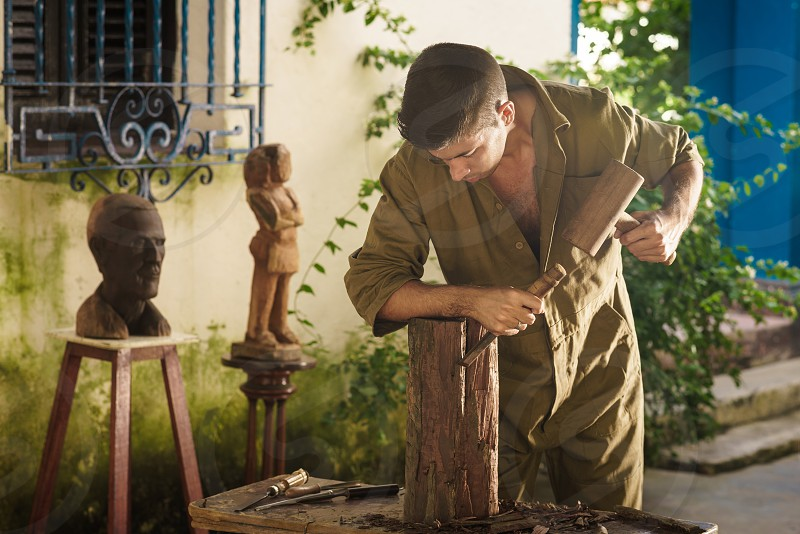 artisan sculptor artist statue wood sculpture taller accuracy adult art atelier beginner beginning block carver carving chisel concentrated concentration crafts craftsmanship craftsman expertise hammer handcrafted handmade hobby instrument job man manual occupation one people person planing precision product profession professional raw sculpting skills tool wooden work worker workshop young photo