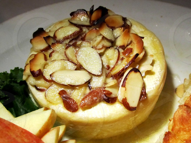 Baked brie topped with almonds photo