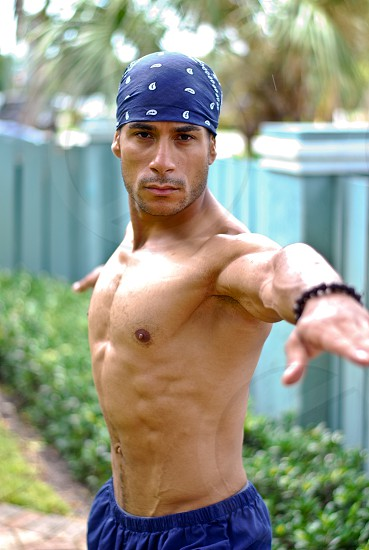 Male who lives a healthy lifestyle doing exercise yoga and martial arts.  runs a fitness and well being program to help others reach fitness goals and feel better about their overall selves. photo