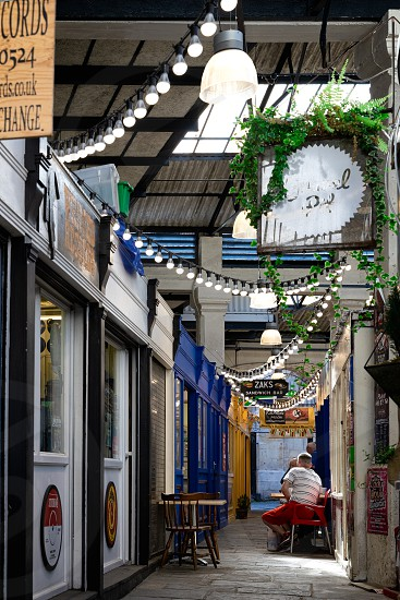 BRISTOL UK - MAY 14 : View of St Nicholas Market buildings  in Bristol on May 14 2019. Three unidentified people photo