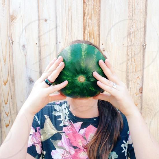 woman holding green watermelon photo