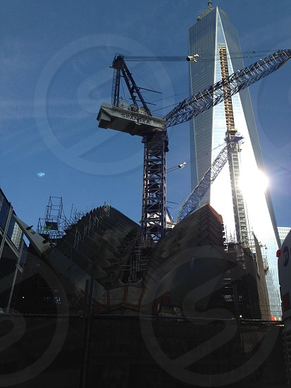 glass high rise building metal crane photo