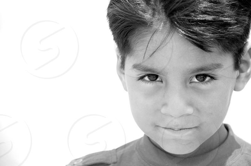 grayscale portrait of boy photo
