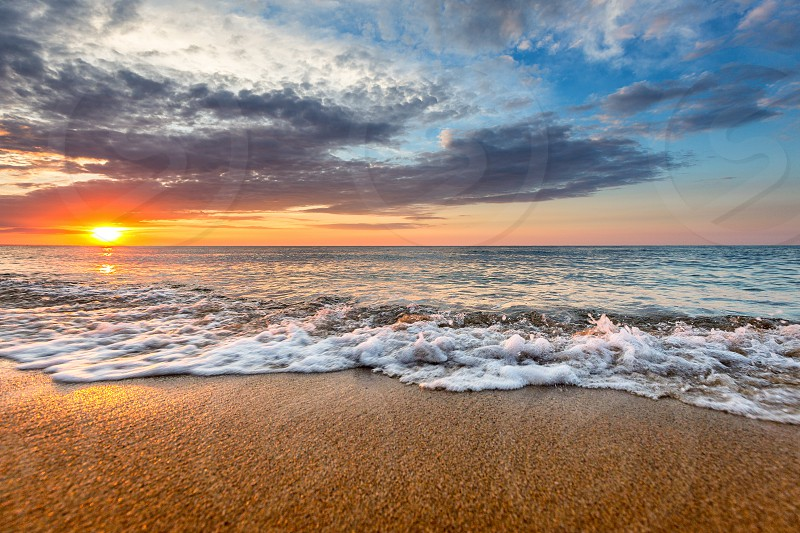 Beautiful sunrise at the beach photo