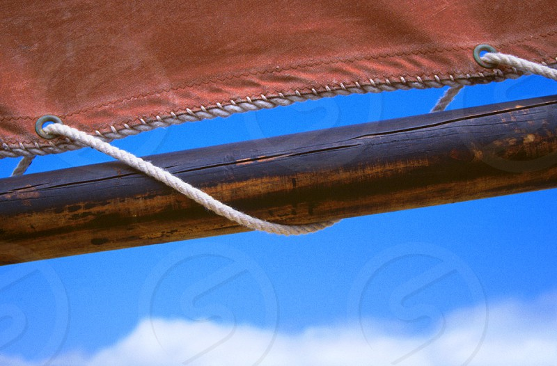 Sailing a wooden boat on a nice summer day. photo