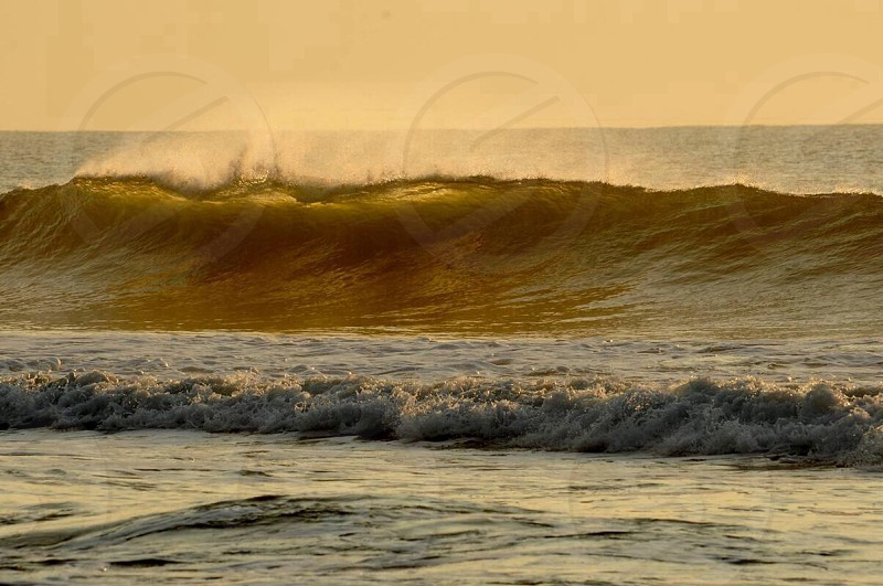 yellow color of water wave from ocean photo