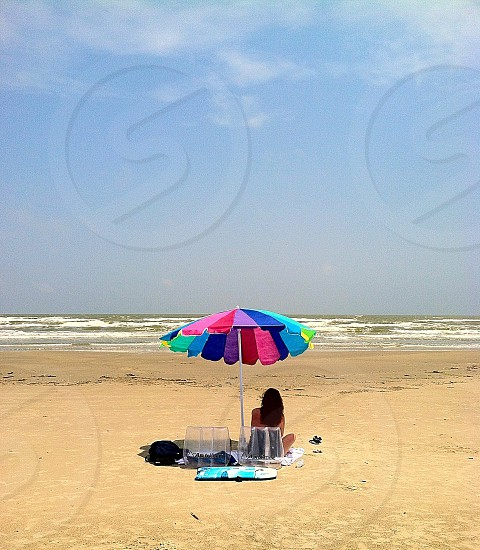 Beach sun sea summer umbrella ocean sand relax rest peace enjoy waves photo