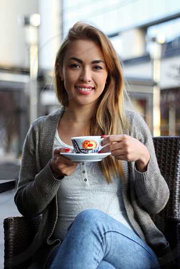 Girl coffee beautiful smile holding cup leisure enjoying happy blonde Asian casual spare time joy attractive young adult cheerful face skin soft lady woman expression positive  photo