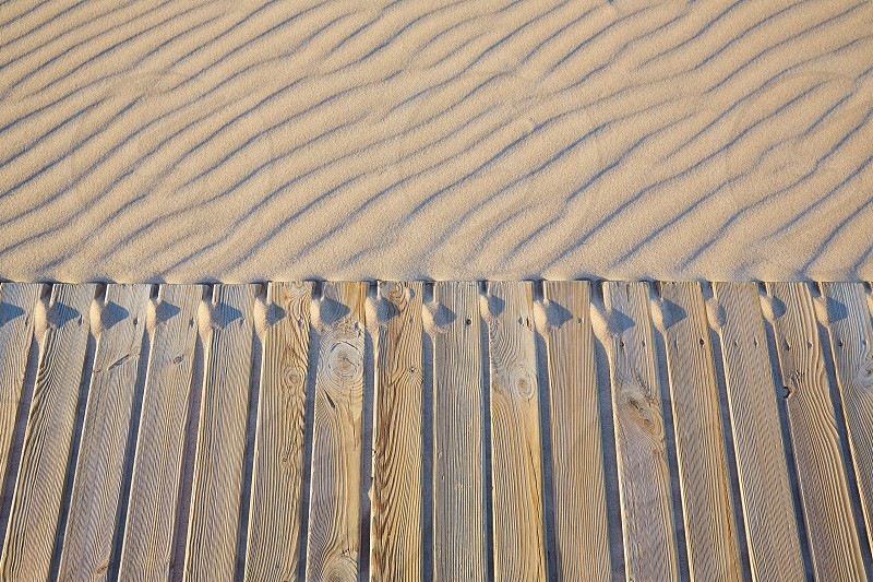 Beach wooden walkway and sand dunes texture wavy in Mediterranean photo