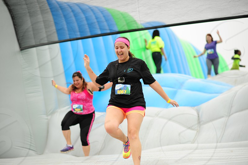 people on grey blue and green bounce house photo