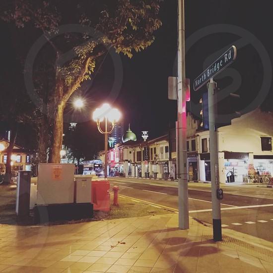 Street going to a place called Haji Lane in Kampong Glam neighborhood of Singapore. #shopping #travel #night #arab #muslim #ethnic #lights #streets photo