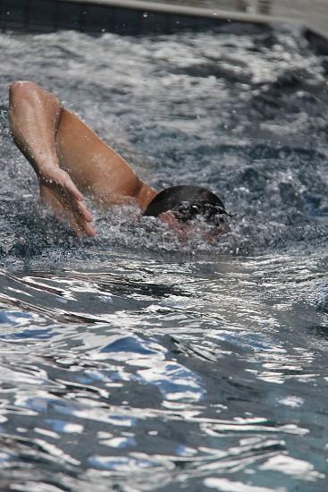 men doing swimming freestyle stroke photo