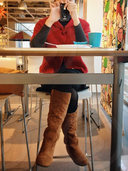person sitting in front of table photo