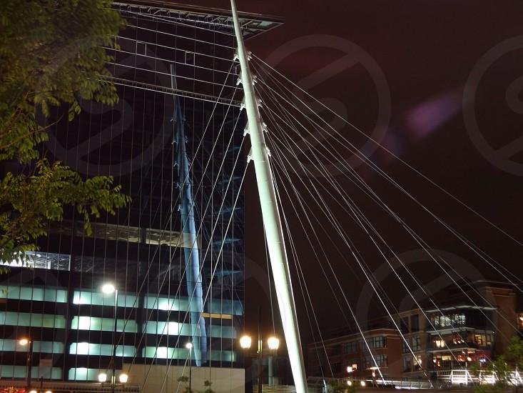 Millennium Bridge and reflection at night photo