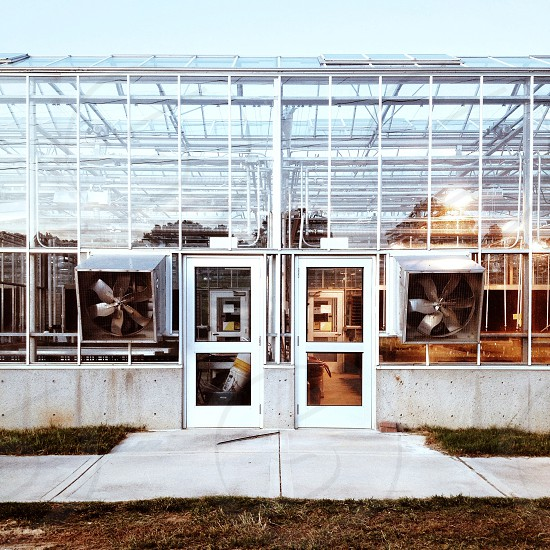 metal structure with white framed clear glass door photo