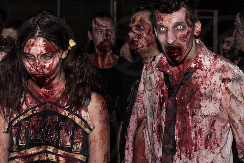 man and woman wearing zombie costume photo