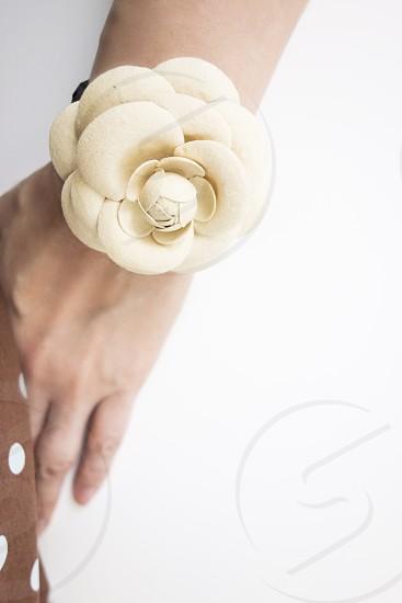 white flower bracelet in arm photo