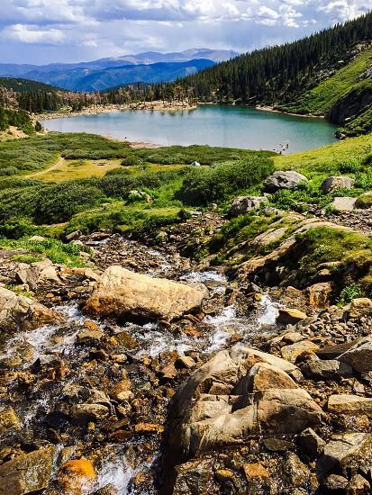 green mountain near water photo