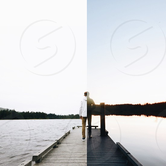 person standing on pier half sunrise half sunset split image photo