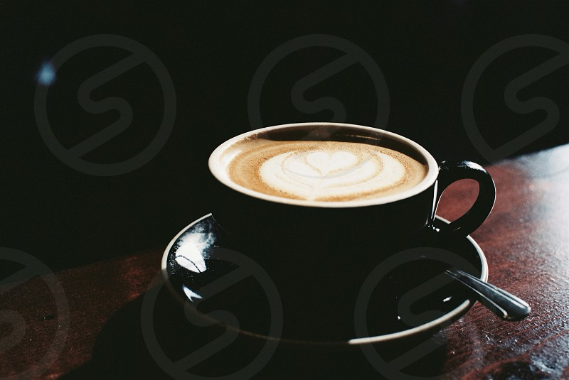 black cup saucer espresso photo
