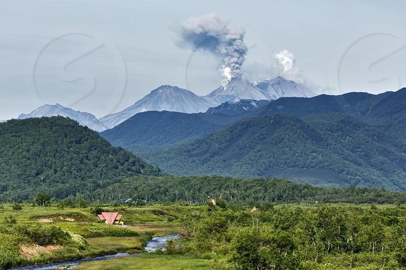 Beautiful summer mountain landscape of Kamchatka: eruption active Zhupanovsky Volcano. Russia Far East Kamchatka Peninsula. photo