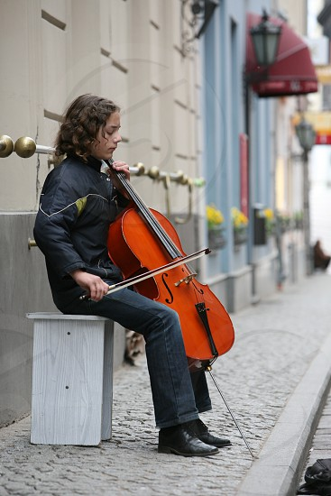 street music in a street in the old town in the city of riga in latvia in the baltic region in europe. photo