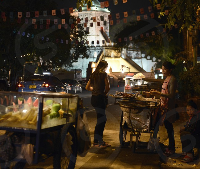 the Fort Sumen by a nightmarket at the Santichaiprakan Park at the Mae Nam Chao Phraya River in the city of Bangkok in Thailand in Southeastasia. photo
