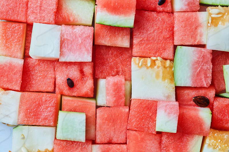 food background from cubes of red watermelon photo